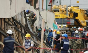 Rescue services and volunteers search for victims under the debris of the Mexico City school that collapsed in the earthquake.