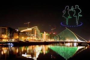 A display by Tourism Ireland, titled Orchestra of Light and featuring a swarm of 500 drones, is animated in the night sky above the Samuel Beckett Bridge on the River Liffey in Dublin. The usual St Patrick's Day celebrations have been cancelled for the second year in a row due to coronavirus