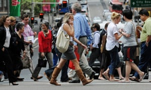 Pedestrians cross a busy intersection in central Sydney (2009)