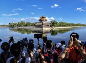 Beijing, China: People take pictures of the Turret at the Palace Museum, also known as the Forbidden City