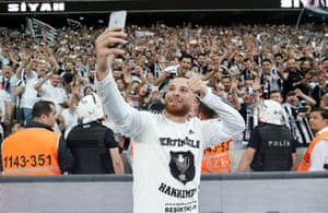 Besiktas' Gokhan Tore celebrates with fans after winning the Turkish Super League Championship earlier this year.
