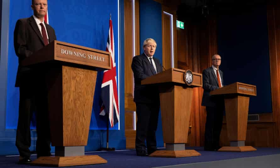 Chief medical officer for England Chris Whitty, Boris Johnson and chief scientific adviser Patrick Vallance at Tuesday's press conference.