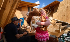 Nine-year-old Keeley Frank holds some of her stuffed animals that her grandparents, Al and Barb Scheidegger, salvaged from their tornado-destroyed storage unit in Jefferson City, Missouri