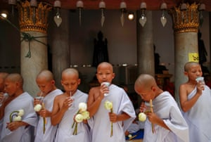 Young monks sip water