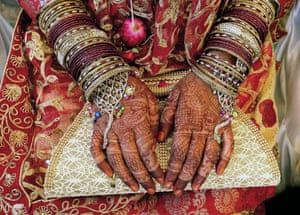 Bhopal, IndiaA bride sits wearing wedding ornaments as she takes part in a mass marriage ceremony with more than 90 other Muslim couples.