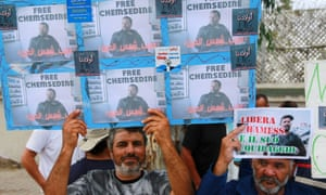 Fishermen rally outside the Italian embassy in Tunis to demand the release of their colleagues.