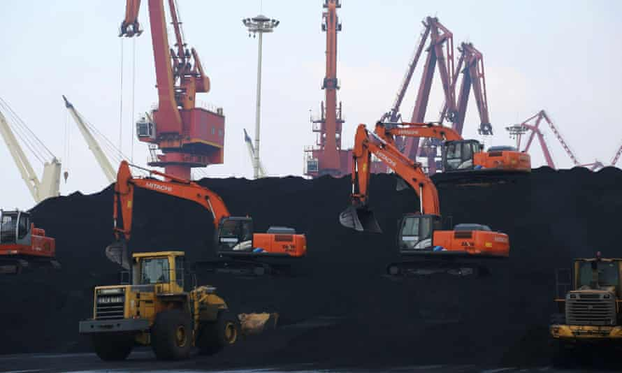 File photo of workers unloading coal at a port in Lianyungang, China