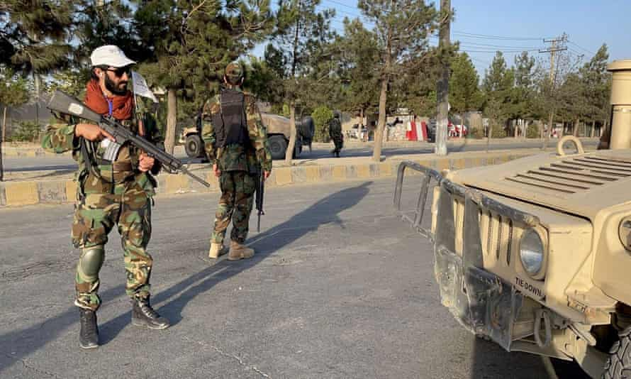 Taliban forces at a checkpoint outside Hamid Karzai international airport in Kabul