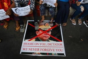Protesters in Yangon step on an image of the country's military chief, Min Aung Hlaing