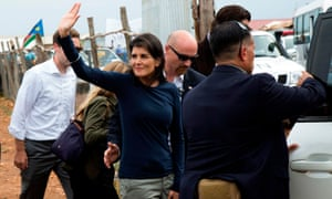 Nikki Haley waves while she is being evacuated by her protection force, following a demonstration in Juba, South Sudan Wednesday.