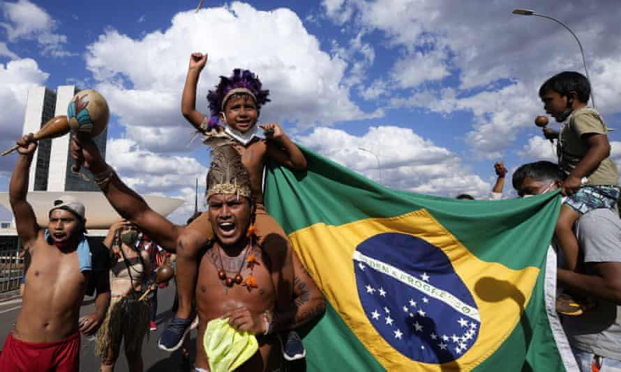 Indigenous protesters shout 'Bolsonaro get out!,' during a march to the supreme court in Brasilia, Brazil, on 1 September 2021, before a ruling on land rights.
