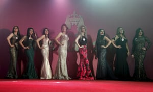 Participants wait for judges to determine the winner of Miss Iraq during the final round of judging in Baghdad.