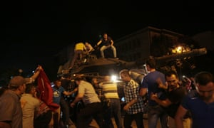 Tanks move into position as Turkish people attempt to stop them in Ankara, Turkey.