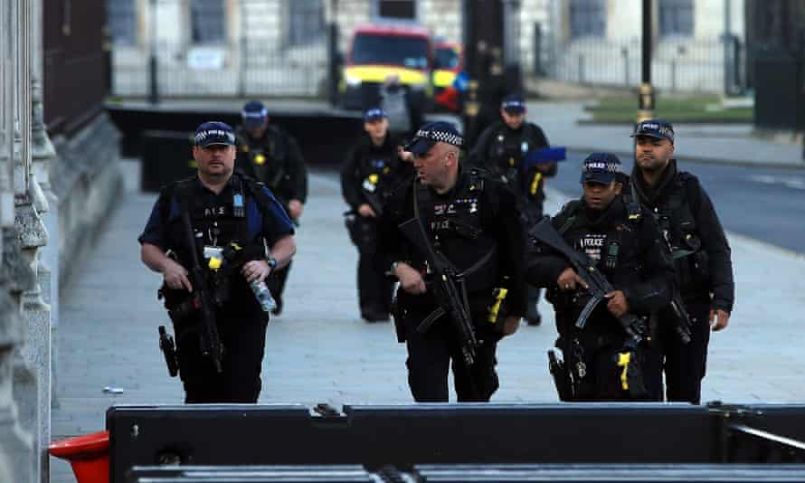 Armed police outside parliament, London, in May 2020
