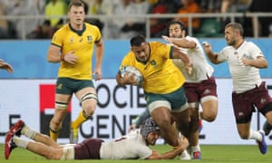Australia's Taniela Tupou is tackled by Georgian defenders.