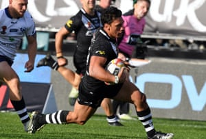 Elijah Taylor of New Zealand heads in for a try against Scotland.