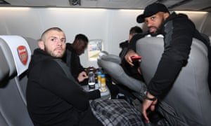 Jack Wilshere, Danny Welbeck and Alex Lacazette prepare for their flight to Madrid on Wednesday.