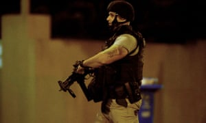 An armed police officer in Brighton on Monday night
