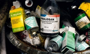 Empty antibiotic and hormone bottles in a bin on a pig farm in Germany