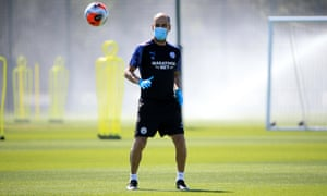 Pep Guardiola takes Manchester City training in a mask as Premier League clubs prepare for the season to restart.