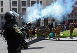Tear gas is fired at supporters of former Bolivian President Evo Morales.
