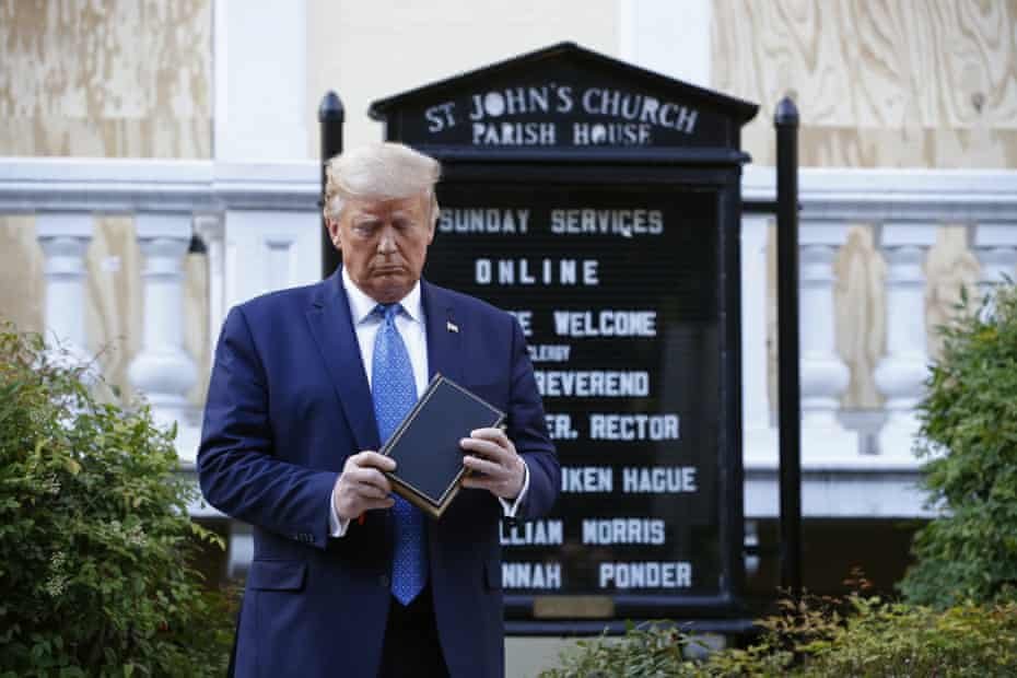 Trump poses with a Bible outside St John's Episcopal church in Washington DC on Monday.