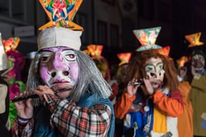 Basel, Switzerland. Revellers wearing masks and lanterns parade through the streets at 4am during Morgestraich, marking the start of the city's carnival