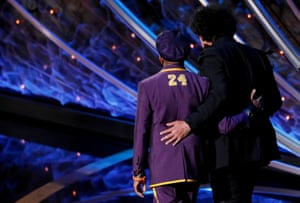 Bong Joon-ho walks off stage with Spike Lee after winning the Oscar for best director for his film Parasite.