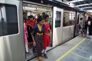 Passengers disembark at Edapally metro station in Kochi