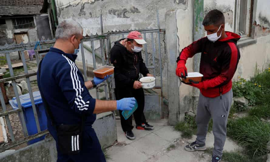 An activist delivers meals to deprived Roma people in Miskolc, Hungary