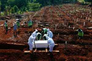 A coffin is interred at the Muslim burial area provided by the government for victims of the coronavirus disease in Jakarta, Indonesia