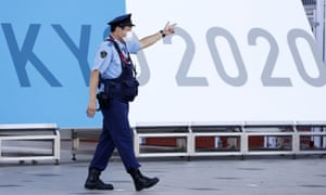 A police officer at the entrance to the Tokyo 2020 press centre today.