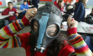 An Israeli girl tries on a gas mask. 'During the Gulf war, Israelis were advised to carry a small bag containing a gas mask and antidotes to a chemical attack at all times.'