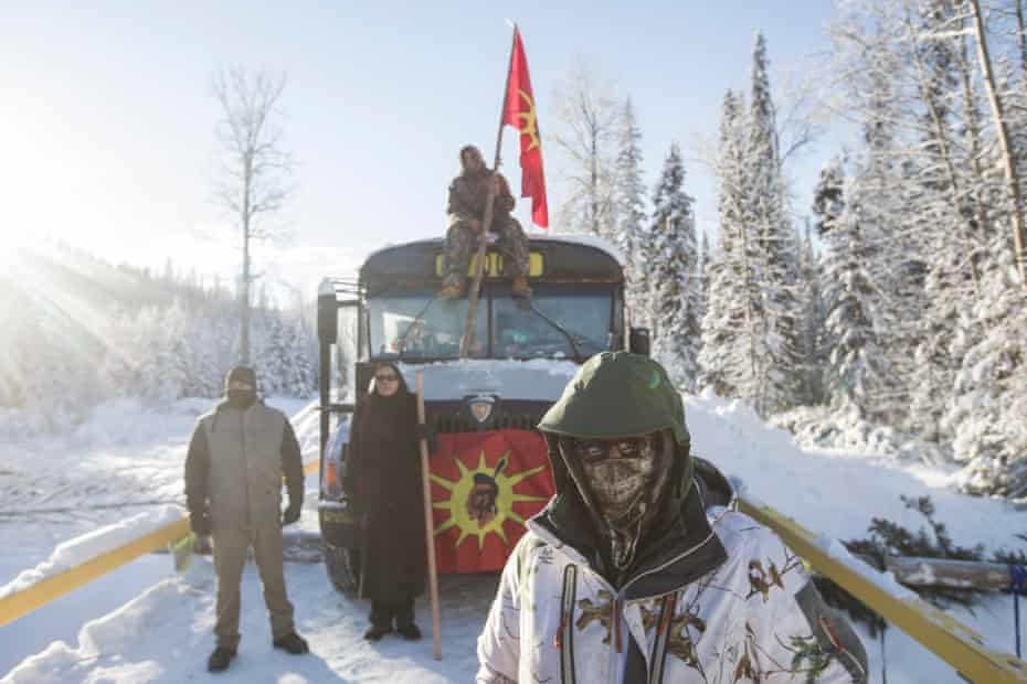 Camp supporters wait for police at the Gidimt'en blockade near Houston, British Columbia.