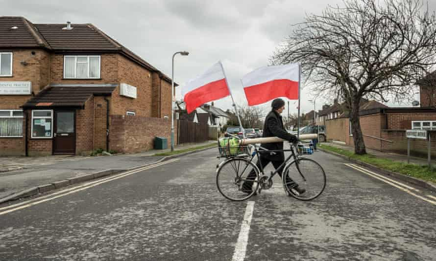 A person with Polish flags heading to a service at the Polish war memorial in London