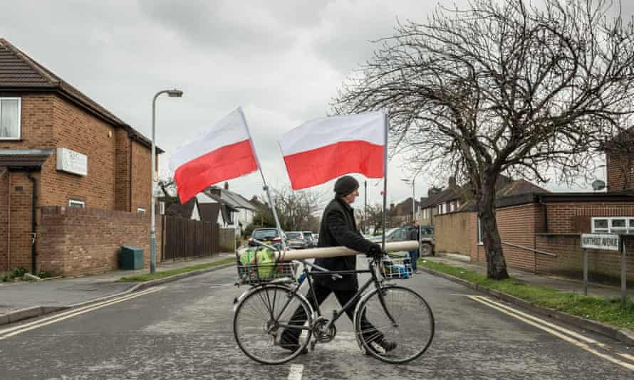A man with Poland flags in South Ruislip, London