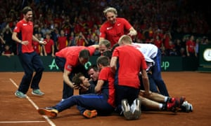 Andy Murray is mobbed by the rest of the Great Britain team after seeing off David Goffin.