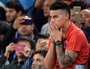Colombia's injured star James Rodriguez looks on nervously as the game enters its closing stages.