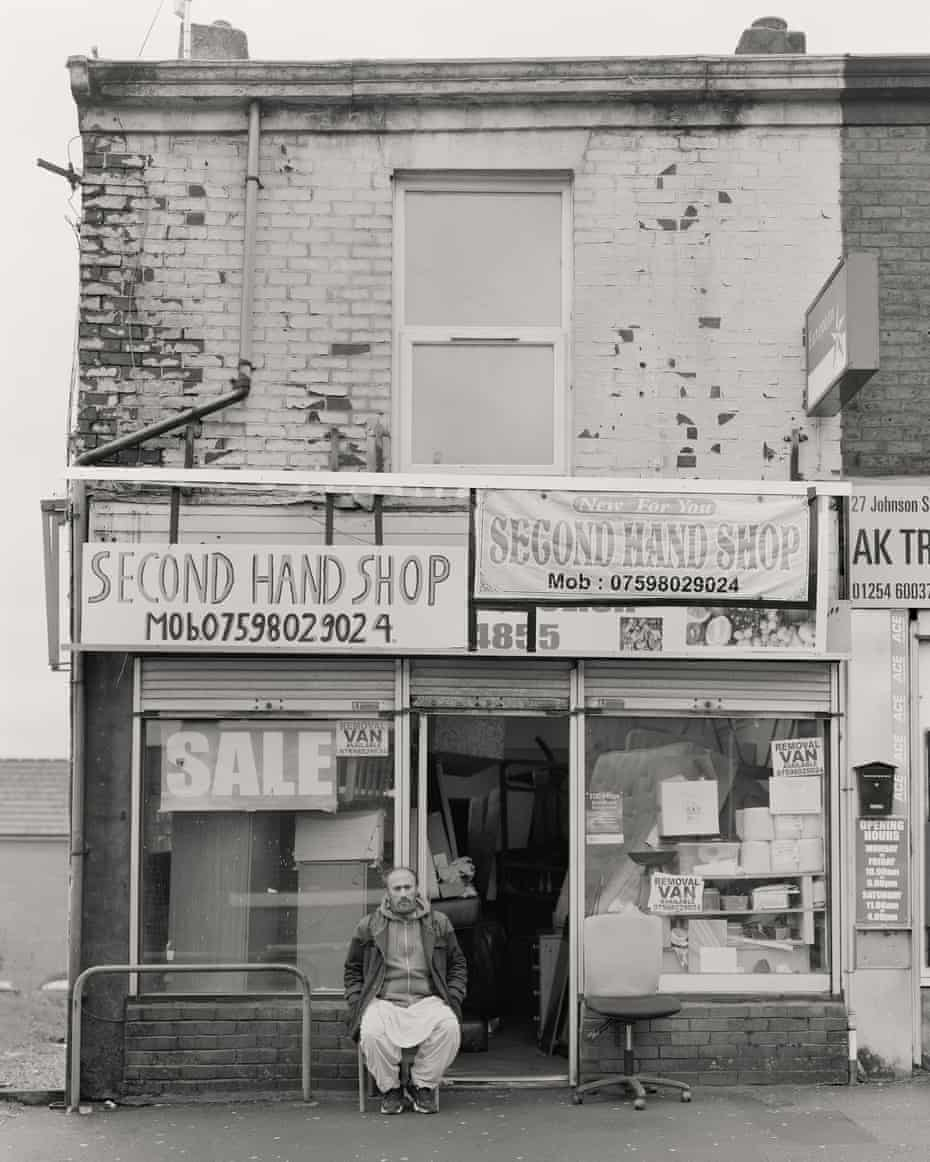 Muhammad Ayub outside his second-hand shop on Johnson Street