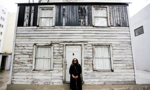 Rhea McCauley, a niece of Rosa Parks, poses in front of the rebuilt house in Berlin, Germany on 6 April 2017.