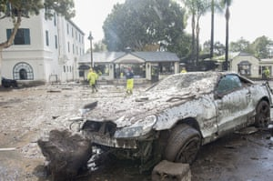 A damaged car that was swept away during a flash flood on Coast Village Road in Montecito