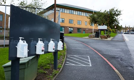 Hand sanitiser bottles stand at the entrance to the Blue Coat school in Oldham.