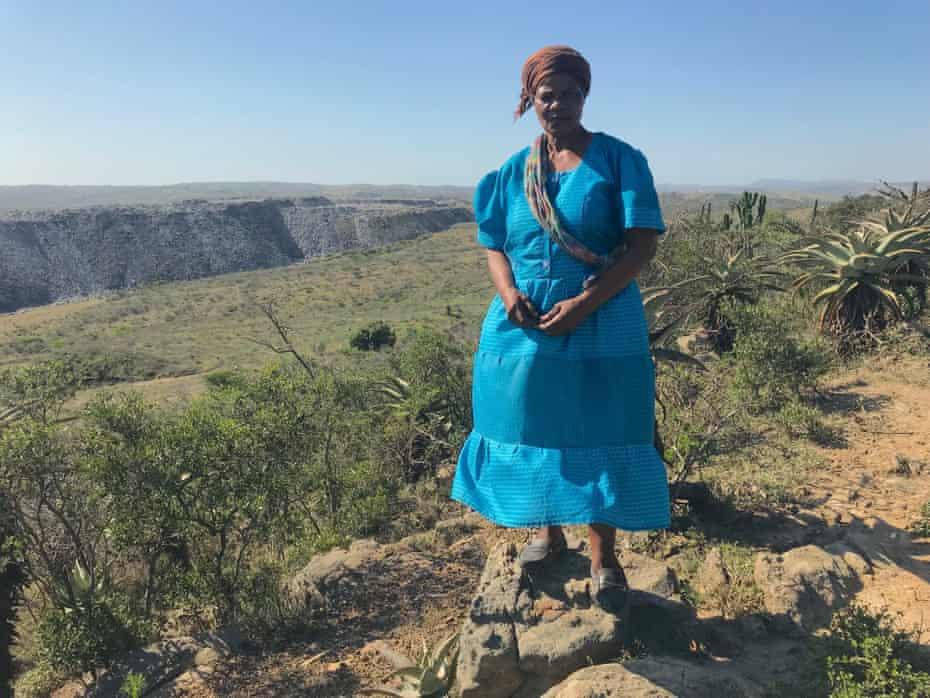 Somkhele resident Thulziwe Jane Dladla, with the opencast coal mine in the background.
