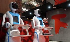 Robot waiters holding trays