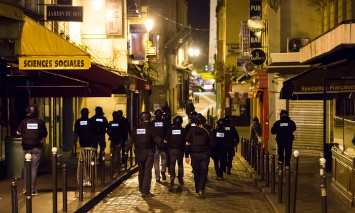 Armed police officers go on foot patrol around the Saint-German neighbourhood after the attacks on Paris