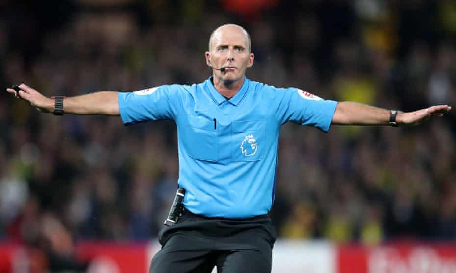 Mike Dean in action.