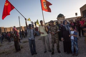 At a demonstration against Turkey, Kurds raise Turkish Marxist-Leninist Communist party flags in protest