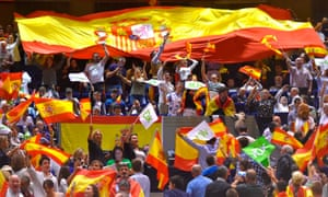 Spanish far-right Vox supporters wave Spanish flags during a campaign rally in Santander. Vox has seen a surge of support.