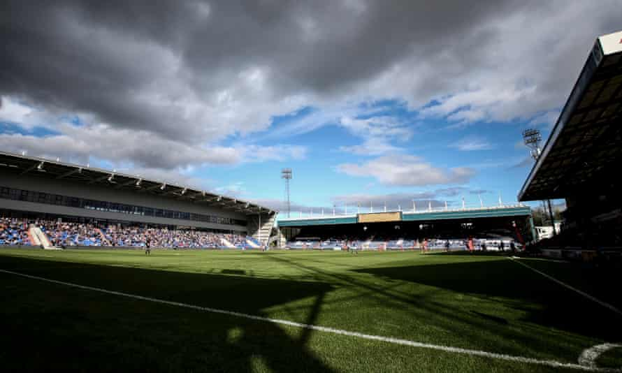 Storm clouds are gathering over Oldham's Boundary Park