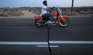 A fault line crack in Highway 178 is opened by a powerful magnitude 7.1 earthquake, triggered by a 6.4 the previous day, near the epicenter in Trona, California.